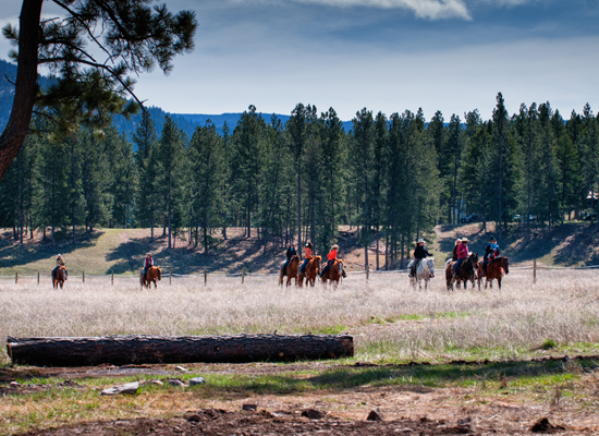 Trail riding at Paws Up Montana Cowgirl Roundup